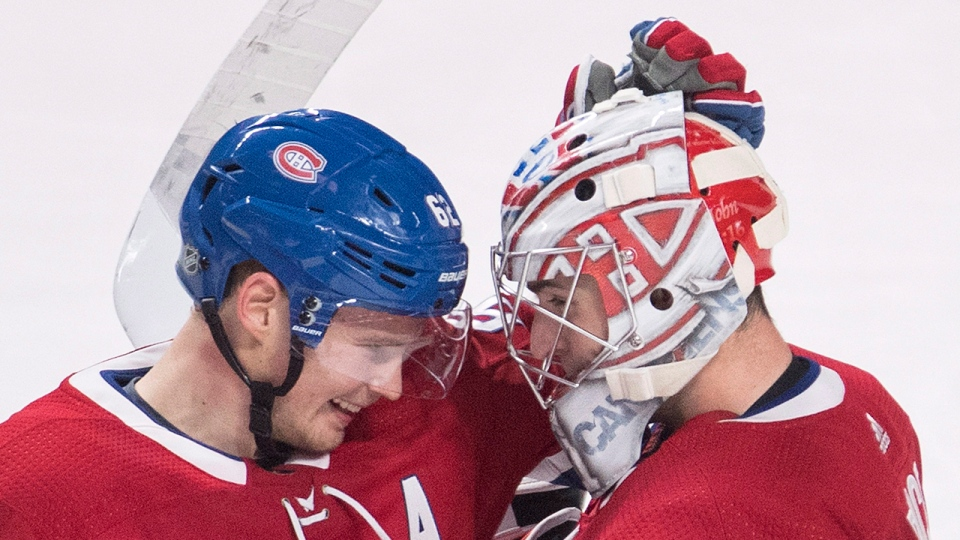 Montreal Canadiens goaltender Carey Price celebrates with teammate Artturi Lehkonen after defeating the Calgary Flames in an NHL hockey game in Montreal, Tuesday, October 23, 2018. THE CANADIAN PRESS/Graham Hughes