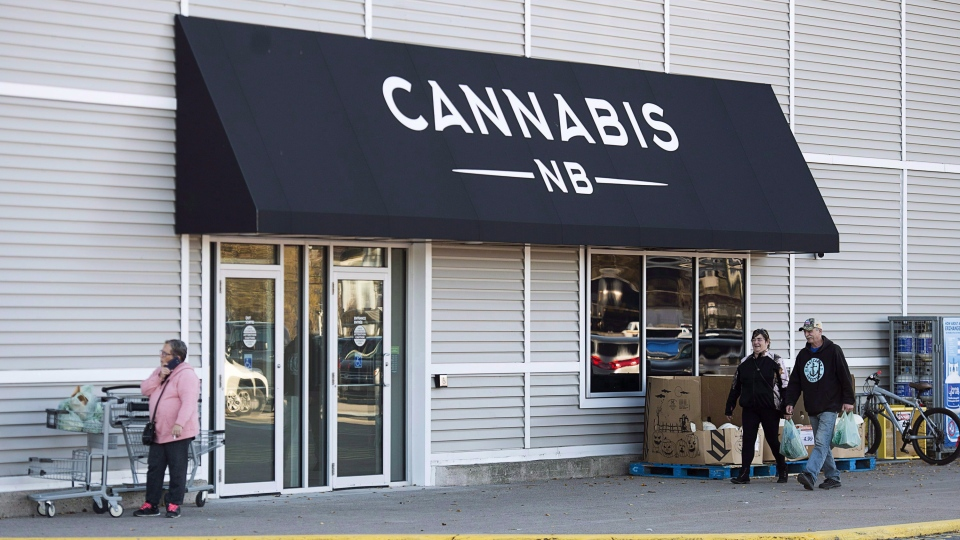 Shoppers, heading from a nearby grocery store, walk past one of the two Cannabis N.B. locations in Saint John, N.B. on October 14, 2018. THE CANADIAN PRESS/Andrew Vaughan