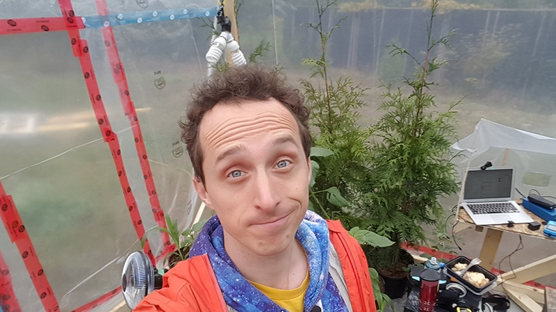 Kurtis Baute sealed himself in an airtight greenhouse with the intention of surviving on plant-produced oxygen for three days, but he was forced to quit the experiment early over high carbon dioxide levels. Oct. 24, 2018. (Twitter/@KurtisBaute)