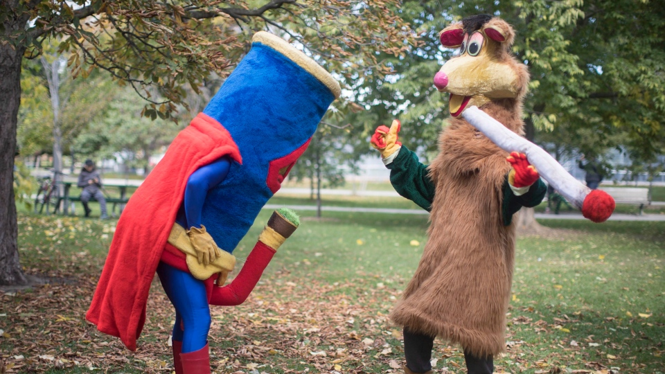 Two costumed figures, including Tokaroo, right, mark the first day of legalization of cannabis across Canada in a Toronto park on Wednesday, October 17, 2018. Mascot maker Mark Scott says he will not buckle to legal threats from Ontario's public broadcaster over his pothead parody of the beloved children's TV character Polkaroo. (THE CANADIAN PRESS/Chris Young)