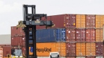 Containers are unloaded at the Port of Montreal in Montreal on July 20, 2017. THE CANADIAN PRESS/Ryan Remiorz