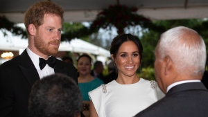 Prince Harry and Meghan, Duchess of Sussex attend a state dinner in Nuku'alofa, Tonga, Thursday, Oct. 25, 2018. Prince Harry and his wife Meghan are on day 10 of their 16-day tour of Australia and the South Pacific. (Paul Edwards/Pool Photo via AP)