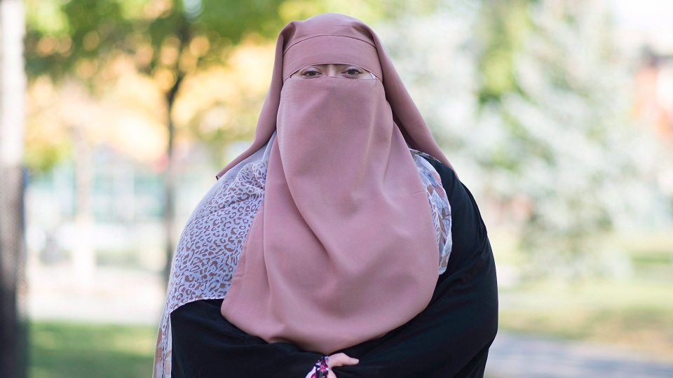 Warda Naili poses for a photograph at a park in Montreal, Saturday, October 21, 2017. Warda Naili says the first time she donned a niqab six years ago, it became a part of her. The Quebec woman, a convert to Islam, said she decided to cover her face out of a desire to practice her faith more authentically and to protect her modesty. (THE CANADIAN PRESS/Graham Hughes)