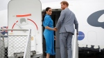Prince Harry and Meghan, Duchess of Sussex wave before departing from Fua'amotu International Airport, Tonga, Friday, Oct. 26, 2018. (Phil Nobel/Pool Photo via AP)