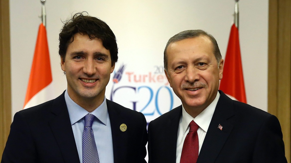 Turkish President Recep Tayyip Erdogan, right, meets with Canada's Prime Minister Justin Trudeau, left, at the G-20 summit in Antalya, Turkey, Monday, Nov. 16, 2015. (Anadolu Agency via AP, Pool)