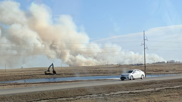 Smoke billowing from a rural area east of Calgary on Friday afternoon (image courtesy: @legageddon)