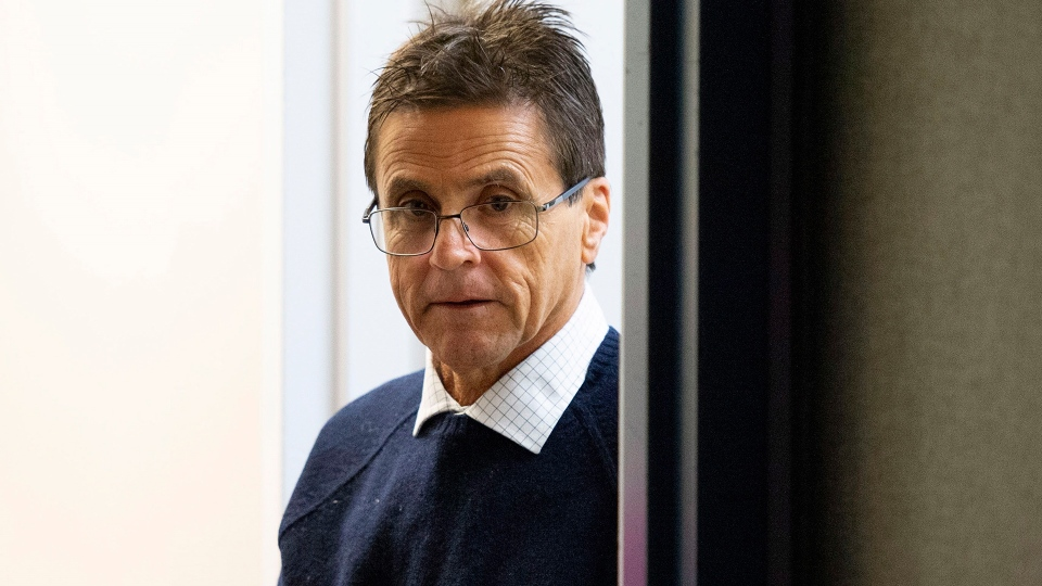 Hassan Diab arrives for a press conference