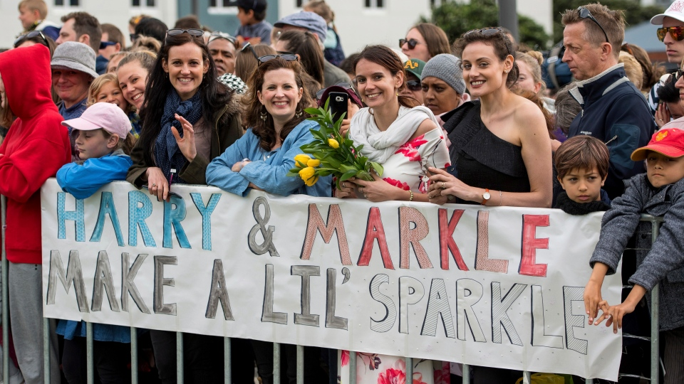 Crowds await the arrival of the Duke and Duchess of Sussex to view the newly unveiled UK war memorial and visit Pukeahu National War Memorial Park in Wellington, New Zealand, Sunday, Oct. 28, 2018. (Dominic Lipinski/Pool Photo via AP)