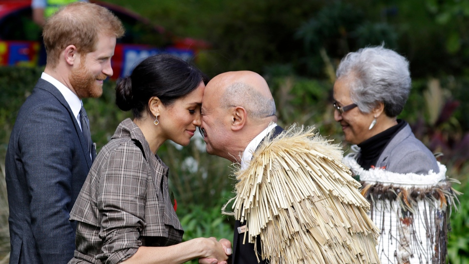 """Meghan, Duchess of Sussex receives a """"hongi"""" a traditional Maori welcome on the lawns of Government House in Wellington, New Zealand, Sunday, Oct. 28, 2018. (AP Photo/Kirsty Wigglesworth)"""