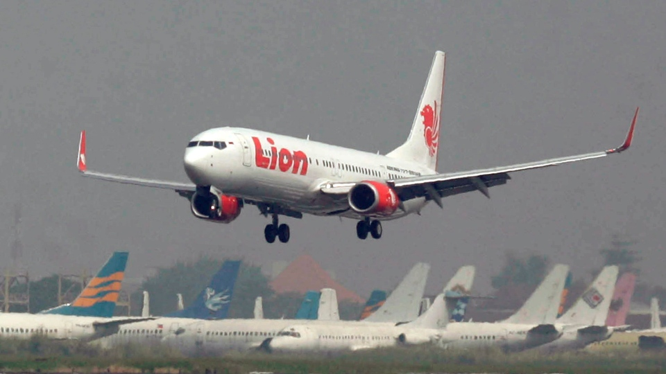 A Lion Air passenger jet plane at Juanda International Airport in Surabaya, Indonesia, in this file photo dated May 12, 2012.  (AP Photo/Trisnadi, File)