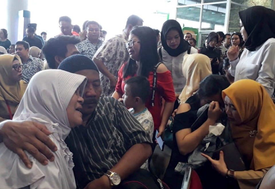 Relatives of passengers comfort each other as they wait for news on a Lion Air plane that crashed off Java Island at Depati Amir Airport in Pangkal Pinang, Indonesia Monday, Oct. 29, 2018. (AP Photo)