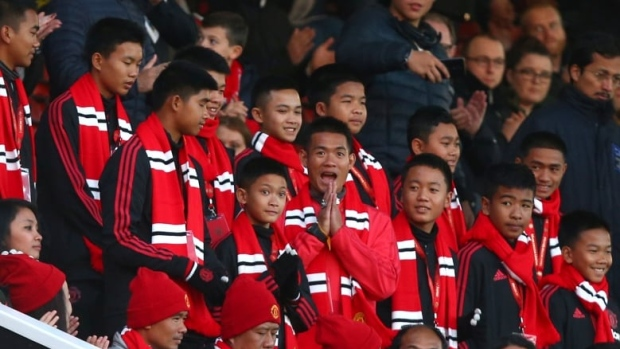 The 12 boys who were trapped with their soccer coach in a flooded cave in northern Thailand earlier this year are seen at an English Premier League soccer match between Manchester United and Everton FC at Old Trafford in Manchester on Sunday. (Dave Thompson/Associated Press)