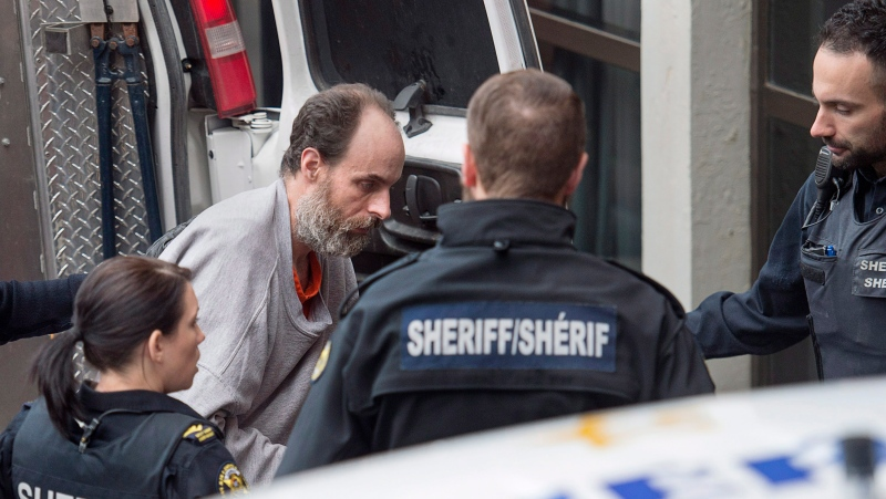 Matthew Vincent Raymond, charged with four counts of first-degree murder, arrives at provincial court in Fredericton on Monday, Oct. 29, 2018. (THE CANADIAN PRESS/Andrew Vaughan)
