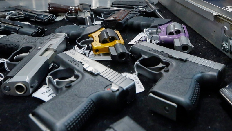 In this Jan. 26, 2013, file photo, handguns are displayed on a vendor's table at an annual gun show in Albany, N.Y. (AP Photo/Philip Kamrass, File)