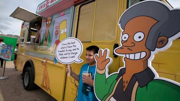 Migael Pimentel, 9, holds up an Apu saying as he has his photo taken at the Simpsons Kwik-E-Mart Truck at South Bites Food during SXSW at the Austin Convention Center, Sunday, March 15, 2015 in Austin, Texas. (AP Photo/Austin American-Statesman, Deborah Cannon)