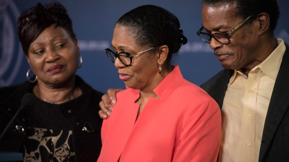 Lyneth Mann-Lewis, centre, of Brampton, Ont., is joined by family members while discussing what it what like reuniting with her son Jermaine Mann, who until recently, was living under an alias in the U.S, during a press conference at Toronto Police Headquarters in Toronto on Monday, Oct. 29, 2018. THE CANADIAN PRESS/ Tijana Martin