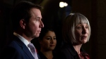 Status of Women Minister Maryam Monsef and Treasury Board President and Digital Government Minister Scott Brison look on as Employment, Workforce Development and Labour Minister Patricia Hajdu speaks during a pay equity announcement in Ottawa, Monday October 29, 2018. THE CANADIAN PRESS/Adrian Wyld