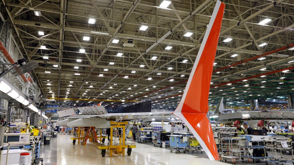 Boeing 737 MAX winglets stand already painted in the Lion Air livery as the wing is assembled at Boeing's airplane production facility Monday, Feb. 13, 2017, in Renton, Wash.  (AP Photo/Elaine Thompson)