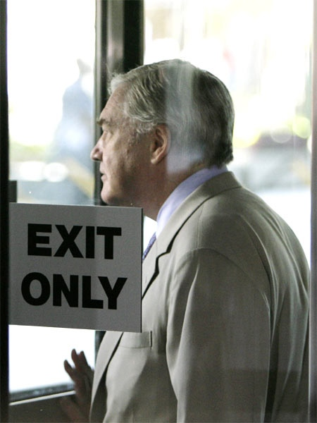 Conrad Black, former head of the Hollinger International Inc. newspaper empire, leaves the federal building in Chicago on July 13, 2007. (AP / M. Spencer Green)