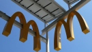This Aug. 8, 2018, photo shows logos of McDonald's Chicago flagship restaurant. McDonald's Corp. reports earnings Tuesday, Oct. 23. (AP Photo/Nam Y. Huh, File)