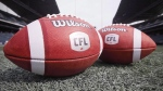 New CFL balls are photographed at the Winnipeg Blue Bombers stadium in Winnipeg, Thursday, May 24, 2018. THE CANADIAN PRESS/John Woods