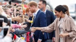 Prince Harry and Meghan, Duchess of Sussex meet members of the public during a walkabout at the Viaduct in Auckland, New Zealand, Tuesday, Oct. 30, 2018. (Chris Jackson/Pool Photo via AP)