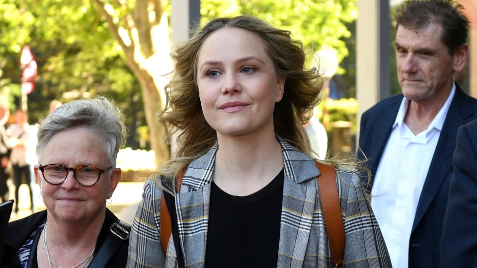 Actress Eryn Jean Norvill, center, leaves the Federal Court in Sydney, Australia, Tuesday, Oct. 30, 2018, after giving evidence during a defamation trial brought on by fellow actor Geoffrey Rush. (Dan Himbrechts/AAP Image via AP)