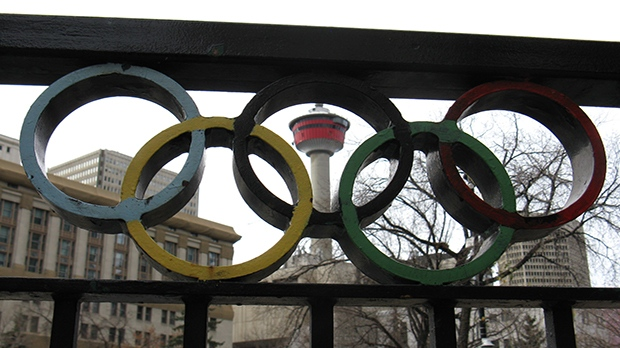 The Calgary Tower is seen through the Olympic Rings at Olympic Plaza.