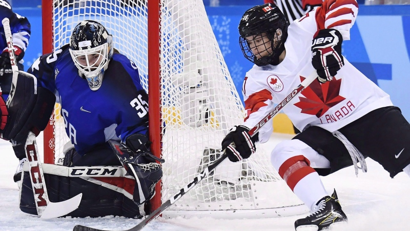United States goaltender Madeline Rooney (35) makes a save on Canada forward Blayre Turnbull (40) during first period women's gold medal final Olympic hockey action at the 2018 Olympic Winter Games in Gangneung, South Korea on February 22, 2018. THE CANADIAN PRESS/Nathan Denette