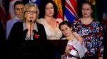 Elizabeth May, Leader of the Green Party, calls on the Government of Canada to urgently intervene in the case of Dr. Elena Musikhina, middle back, in Ottawa on Tuesday, Oct. 30, 2018. (THE CANADIAN PRESS / Sean Kilpatrick)