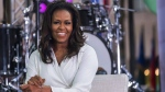 "Michelle Obama participates in the International Day of the Girl on NBC's ""Today"" show at Rockefeller Plaza on Thursday, Oct. 11, 2018, in New York. (Photo by Charles Sykes/Invision/AP)"