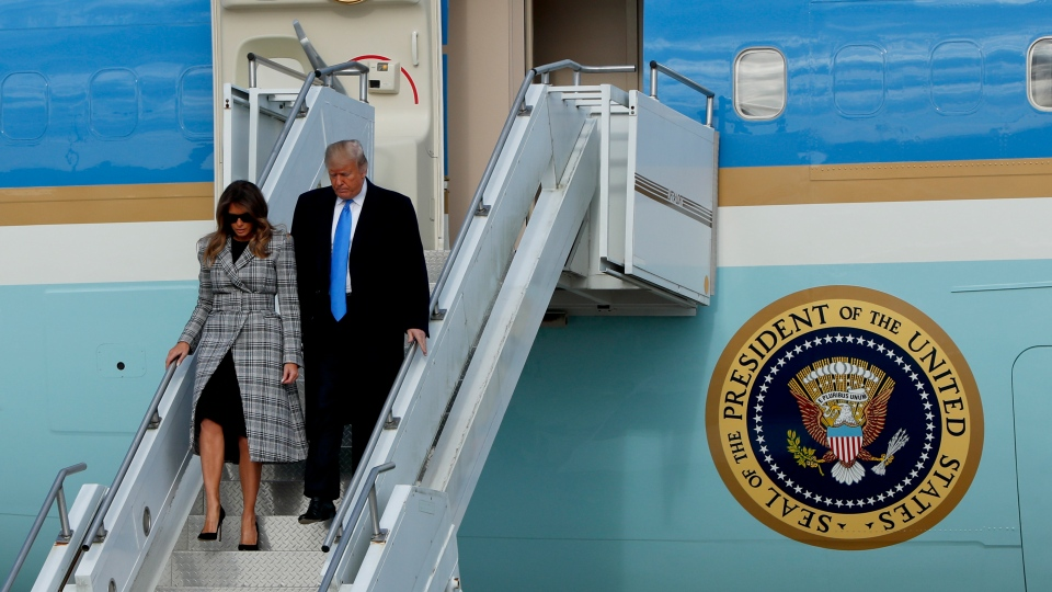U.S. President Donald Trump departs Air Force One as he arrives with first lady Melania Trump on Tuesday, Oct. 30, 2018 in Coraopolis, Pa. (AP Photo/Keith Srakocic)