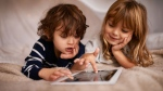 A new study advises limits on screen time for children and teenagers to help boost their well-being.(PeopleImages / IStock.com)