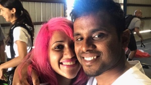 This photo obtained from Facebook posted on June 26, 2017, shows a selfie of Vishnu Viswanath, right, and his wife Meenakshi Moorthy at Skydive Santa Barbara in Lompoc, Calif. (Vishnu Viswanath/Facebook via AP)