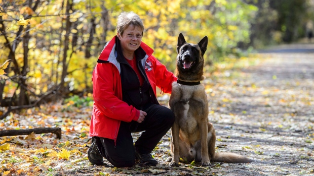 Kim Cooper of the Ottawa Valley Search and Rescue Dog Association is seen with her dog Grief in Stittsville, Ont., on Tuesday, Oct. 30, 2018. THE CANADIAN PRESS/Sean Kilpatrick