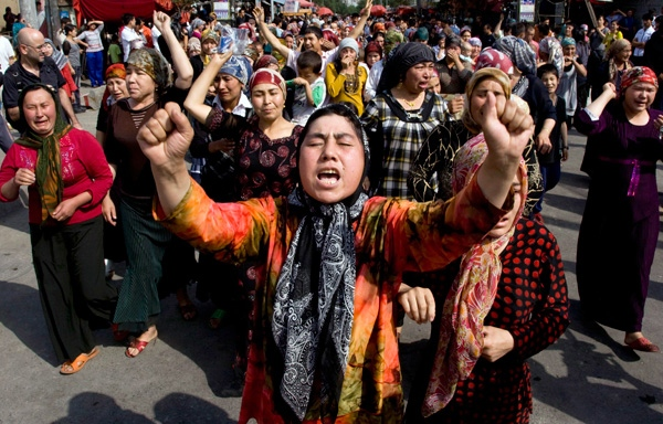 A group of Uighurs protest in front of journalists visiting the area in Urumqi, China, Tuesday, July 7, 2009. (AP / Ng Han Guan)