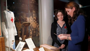 Kate, the Duchess of Cambridge, visits IWM, the Imperial War Museum, to view letters relating to the three brothers of her great-grandmother, all of whom fought and died in the First World War, in London, Oct. 31, 2018. (AP Photo/Frank Augstein, pool)