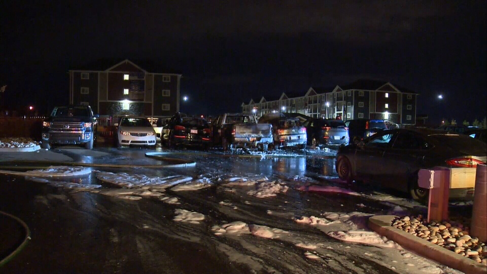 Crews were called to a condominium building in southwest Edmonton around 3:30 a.m. where a fire damaged four vehicles.