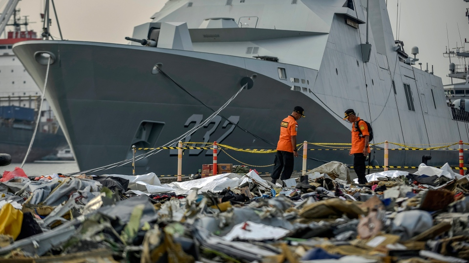 Members of National Search and Rescue Agency inspect debris retrieved from the waters where Lion Air flight JT 610 is believed to have crashed, at Tanjung Priok Port in Jakarta, Indonesia, Wednesday, Oct. 31, 2018. (AP / Fauzy Chaniago)
