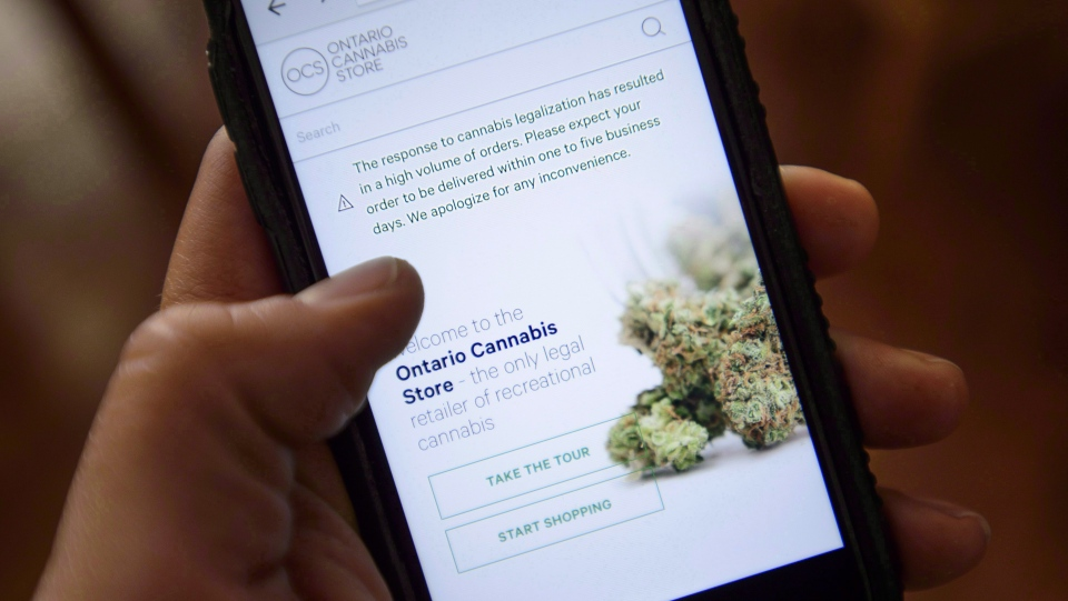 The Ontario Cannabis Store website is pictured on a mobile phone Ottawa on Thursday, Oct. 18, 2018.  (THE CANADIAN PRESS/Sean Kilpatrick)