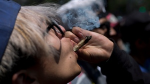 In this April 20, 2018 file photo, a young man smokes marijuana to celebrate the International Day for Cannabis in Mexico City. (AP Photo/Eduardo Verdugo, File)