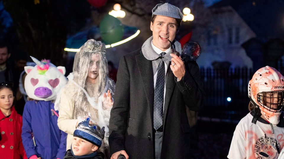 Prime Minister Justin Trudeau walks with his son Hadrien as they go trick or treating at Rideau Hall on Halloween in Ottawa on Wednesday, Oct. 31, 2018. THE CANADIAN PRESS/Justin Tang