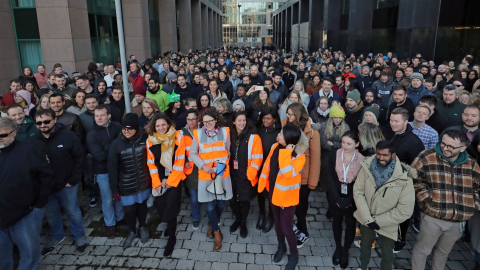 Google employees outside its European headquarters in Dublin, Ireland, Thursday Nov. 1, 2018. (Niall Carson/PA via AP)