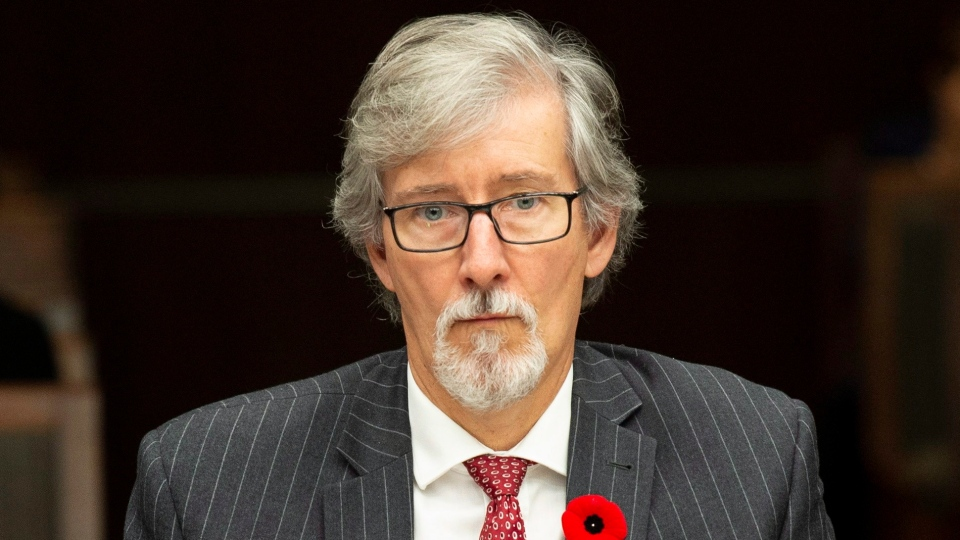 Privacy Commissioner Daniel Therrien waits to appear at the House of Commons information, privacy and ethics committee in Ottawa, Thursday November 1, 2018. THE CANADIAN PRESS/Adrian Wyld