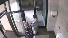 Two people holding a door open