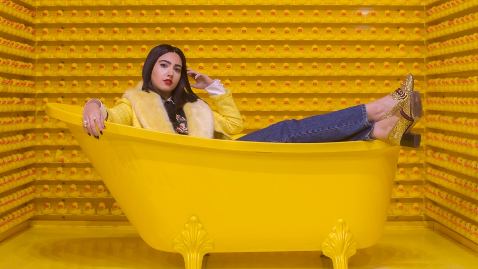 "Instagram influencer Negin Tavana, whose page @Negzila has more than 35,000 followers, is pictured at the pop art installation ""Happy Place"" in Toronto, on Monday, October 29, 2018. (THE CANADIAN PRESS/Chris Young)"