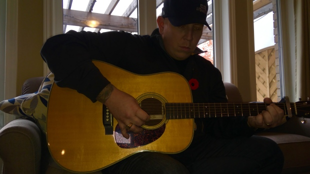 Veteran uses music to battle PTSD Image