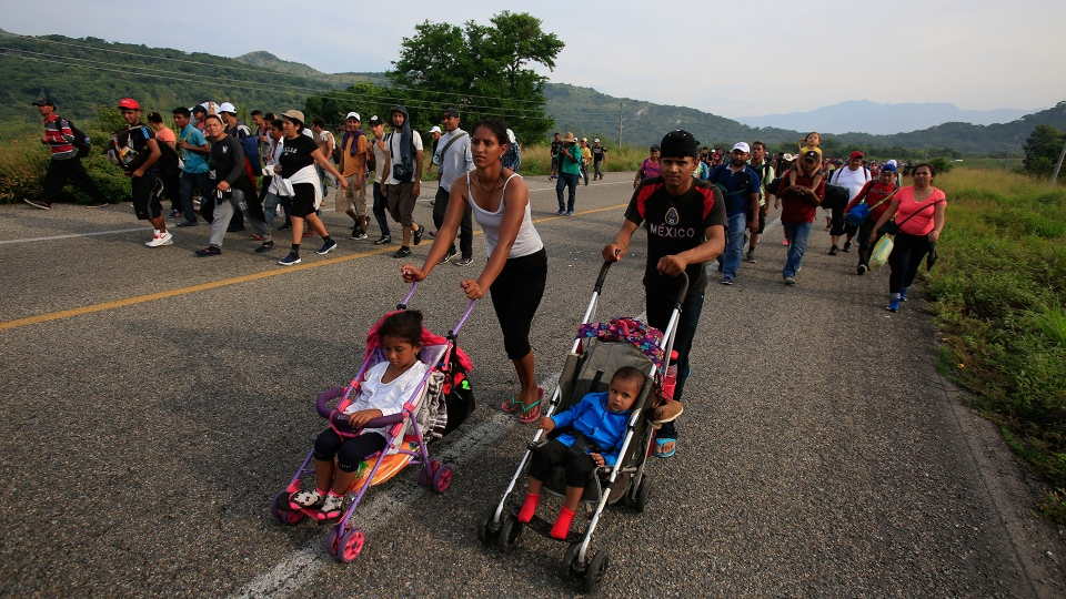 Migrants push strollers carrying young children as their caravan pushes on from Arriaga, Chiapas state, Mexico, Saturday, Oct. 27, 2018. (AP / Rebecca Blackwell)