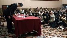 Japanese journalist Jumpei Yasuda bows in Tokyo