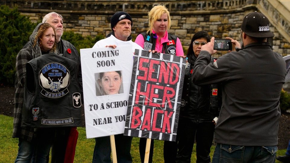Rodney Stafford, third from left, father of Tori Stafford, poses for a photo with supporters during a 'Justice for Tori' protest on Parliament Hill in Ottawa on Friday, Nov. 2, 2018. (Sean Kilpatrick / THE CANADIAN PRESS)